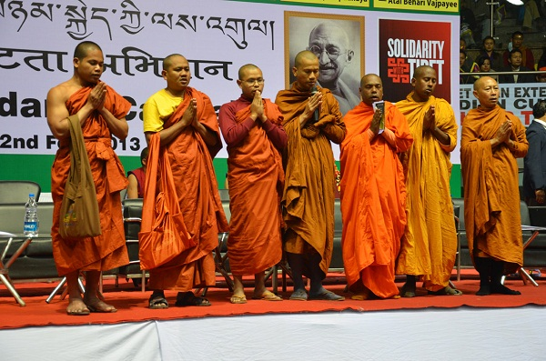 Monks from various buddhist countries reciting prayers.