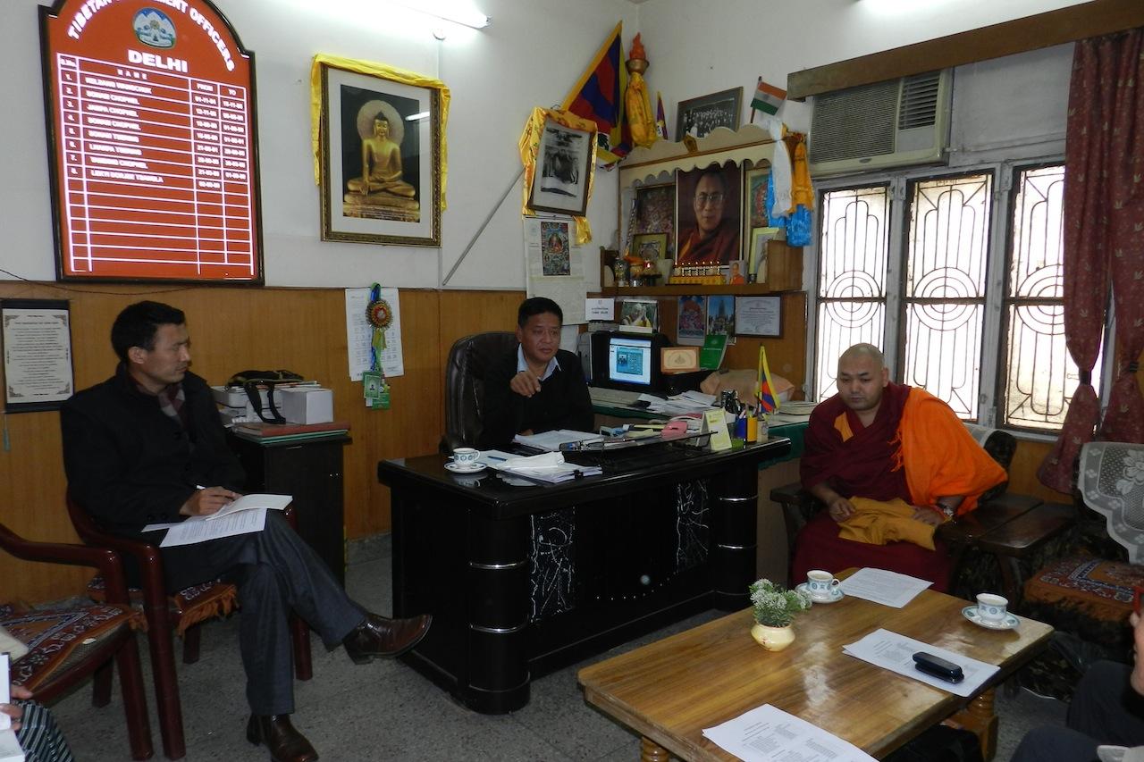 Speaker Penpa Tsering and Tibetan Parliament members at a general meeting